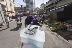 Ice vendor. Highe temperatures in Indochina are reason that ice vendors still have lot of work. They supply markets and street restaurants as it is much cheaper Stock Photography