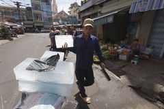 Ice vendor. Highe temperatures in Indochina are reason that ice vendors still have lot of work. They supply markets and street restaurants as it is much cheaper Royalty Free Stock Photo