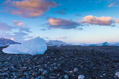 Ice on volcano sand rock Royalty Free Stock Images