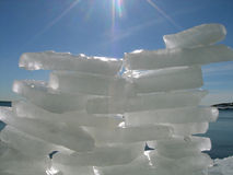 Ice wall. Ice fortress on a background of the dark blue sea stock photo