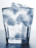Ice water. Glass of ice water on blue background Royalty Free Stock Photo