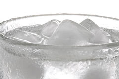 Ice Water. Glass of fresh water cooled with ice cubes Stock Image