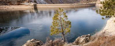 Ice on the water of Arrow Rock Dam on the Boise River in Idaho. Upper backwater above a larger cement hydroelectric Dam on the Boise River in Idaho stock images