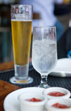 Ice Water and Beer Stock Photography