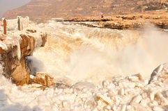 Ice Water Fall. Hukou Water Fall with ice and rainbow, The Yellow River,  Winter Royalty Free Stock Image
