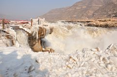 Ice Water Fall. Hukou Water Fall with ice and rainbow, The Yellow River,  Winter Stock Image