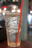 Ice and water in glass on dining table. Stock Photo