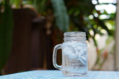 Ice water in the glass jar Royalty Free Stock Photography