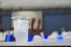 Ice water in glass-plastic in seminar conference room background. select focus with shallow depth of field stock images