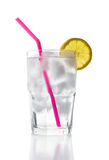 Ice Water with Lemon, Straw. A glass of ice water with a lemon slice and straw, isolated on white Stock Images