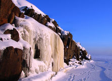 Ice waterfall. Rock and blue sky royalty free stock photos