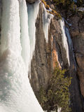 Ice waterfall on a rock Royalty Free Stock Image