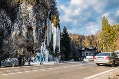 Ice waterfall. Wonders of nature. Natural winter attraction in northern Italy. Valganna Caves of karstic origin Stock Photos