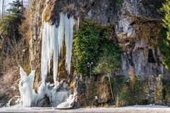 Ice waterfall. Wonders of nature. Natural winter attraction in northern Italy. Valganna Caves Royalty Free Stock Photography