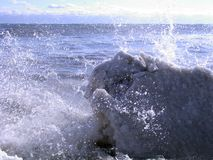 Ice Waves 04. Ocean waves crash along an icy winter shoreline stock images