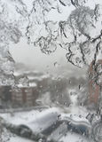 Ice on window against street under snow Stock Photo