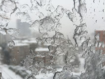 Ice on window against street under snow Royalty Free Stock Photo