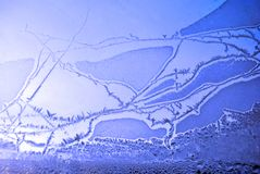 Ice on the window glass, natural background texture close-up. Detail royalty free stock photography