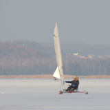 Ice-yacht sailing. Ice-boat sailing on the water basin Royalty Free Stock Images