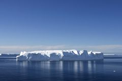 Iceberg. Floating in Antarctic waters Stock Images