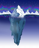 Iceberg. Nighttime view of an iceberg with visible underwater surface. Aurora effect in the background Royalty Free Stock Photos
