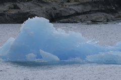 Iceberg. An iceberg floating in the water Stock Image