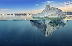 Iceberg with above and underwater view. Taken in greenland Royalty Free Stock Image