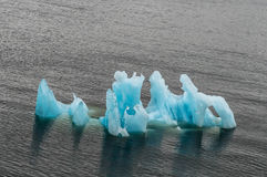 Iceberg ahead during a summer cruise. Iceberg in Alaska during a cruise. Showing the bright blues of the ice in the oceans water stock photography