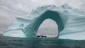 Iceberg arch like Darwin arch in Galapagos Islands stock video footage