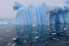 Iceberg and azure water Stock Photos