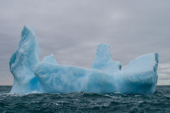 Iceberg 1. A beautiful iceberg drifts in the Southern Ocean near Antarctica. Icebergs originate from glaciers and can be massive. Different colors within royalty free stock images