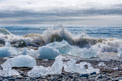 An iceberg being broken by the waves at Jokulsarlon - Iceland Royalty Free Stock Photography