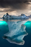 Iceberg. Big iceberg undewater with a small part floating royalty free stock image