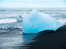 Iceberg on black beach Royalty Free Stock Photos