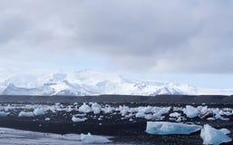 Iceberg on the black rock beach Royalty Free Stock Image