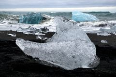 Iceberg on black sand beach, Glacier Lagoon, Iceland Royalty Free Stock Image