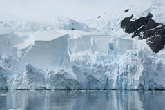 Iceberg breaks off from a glacier. Royalty Free Stock Photo