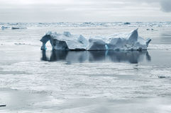 Iceberg in calm waters Royalty Free Stock Image