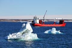 Iceberg and cargo ship Royalty Free Stock Photos