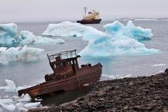 Iceberg and cargo ship Royalty Free Stock Photography