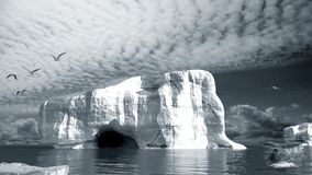 Iceberg with cave Stock Images