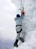 Iceberg climber. Climber climbing the iceberg Royalty Free Stock Photos