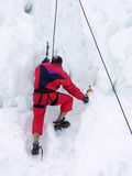 Iceberg climber. Climber climbing the iceberg stock photos