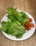 Iceberg de Frille avec de la salade de tomate Images stock