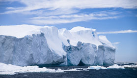 Iceberg Designs. A uniquely eroded iceberg under the sun and blue skies Stock Photography