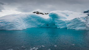 Iceberg drifting in the aquamarine sea. This shot was made during expedition to Antarctica in January 2012 Royalty Free Stock Photo