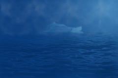 Iceberg drifting in the ocean Royalty Free Stock Photo