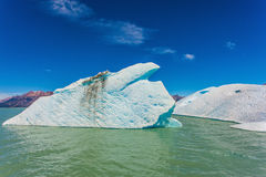 Iceberg drifts from coastal glacier in summer day Royalty Free Stock Image