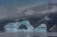 Iceberg in the fjords of Scoresby Sund, East Greenland royalty free stock images