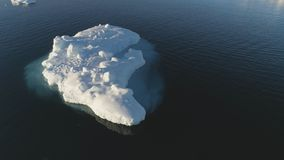 Iceberg float in clear water ocean drone above view